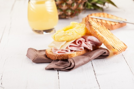 Delicious Toast Hawaii on wooden table with juice photo