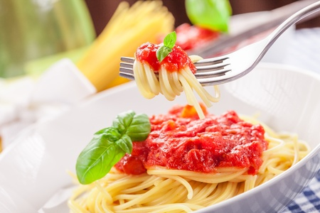 Italian Spaghetti with tomato sauce on traditional home towel