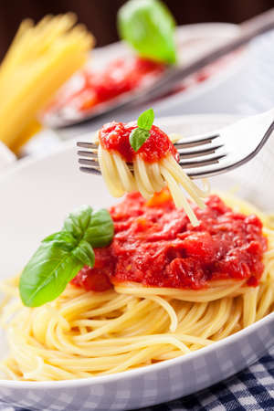 Italian Spaghetti with tomato sauce on traditional home towel  photo
