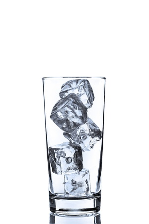 photo of empty glass with ice cubes on white background photo