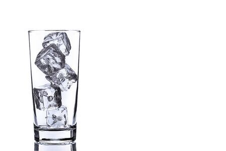 ice water: photo of empty glass with ice cubes on white background