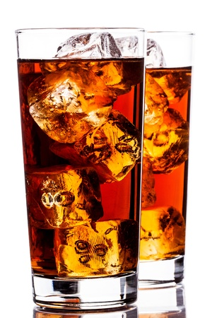 thirst quenching: photo of ice tea with ice cubes on white background