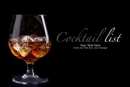 photo of whiskey cognac on black background
