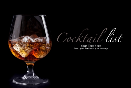 whiskey glass: photo of whiskey cognac on black background