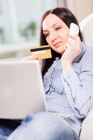 Woman with notebook buying something with creditcard onlineshopping concept photo
