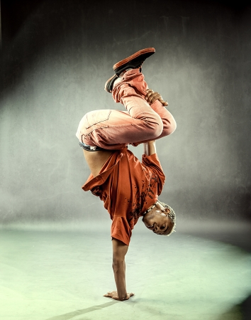 break dancer: boy who is posing his dance movements in front of the camera Stock Photo