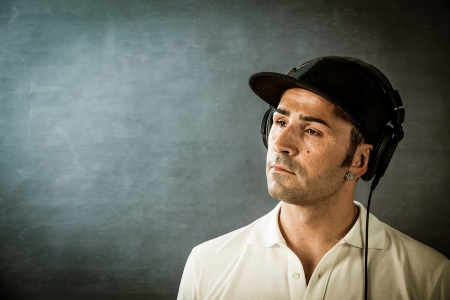 photo of dj with headphones in front of a rural background photo