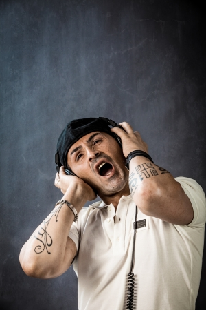 photo of young dj with headphones singing his song  photo