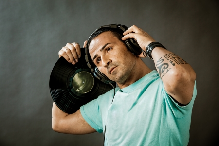 photo of a man with headphones and vinyl on rural background photo
