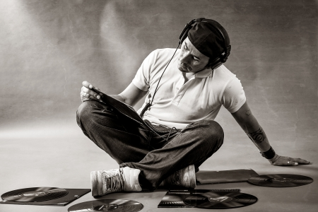 Black and white portrait of a dj sitting on the floor with vinyls Stock Photo - 13965781