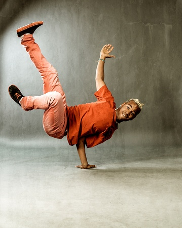 image of a guy performing acrobatic dance movements photo