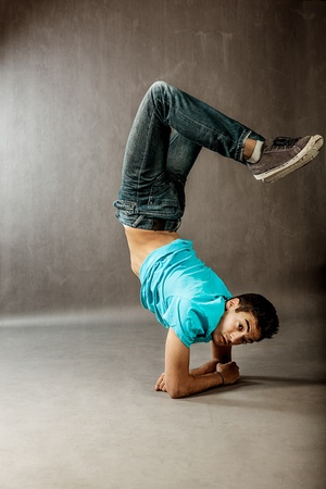 break dance: image of a guy performing acrobatic dance movements