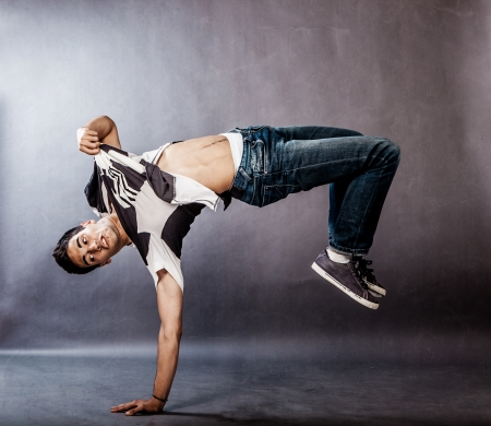 image of a dancer who is performing extreme break dance movements photo