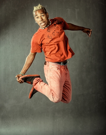 image of a dancer who is jumping high performing his movement  photo