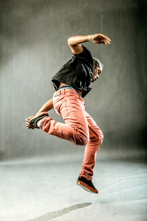 image of a boy who is posing his dance movements in front of the camera photo