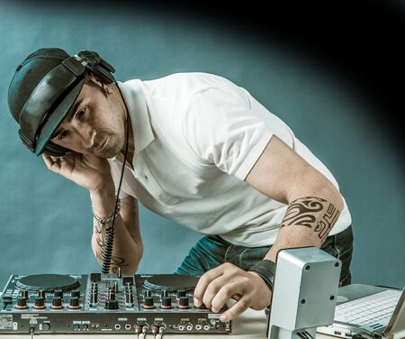 DJ with mixer is working , foto with copyspace photo