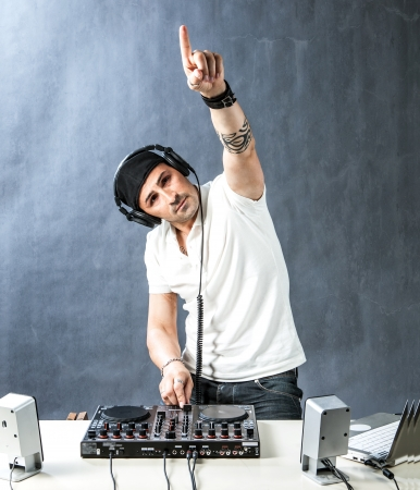 DJ with mixer is working  photo