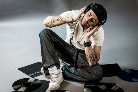 image of a DJ with vinyls on the floor listening his music Stock Photo - 14199625