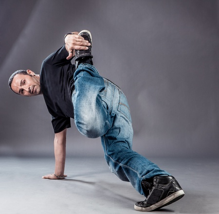 break dancer: image of a  break dancer who is performing his move
