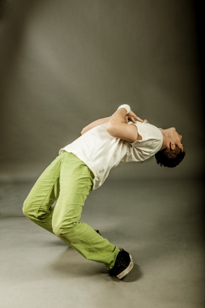 dance pose: image of a  break dancer who is performing his move