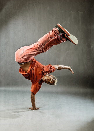 image of a  break dancer who is performing his move   photo