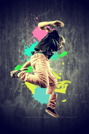image of a  break dancer who is performing a jump with splashes  Stock Photo