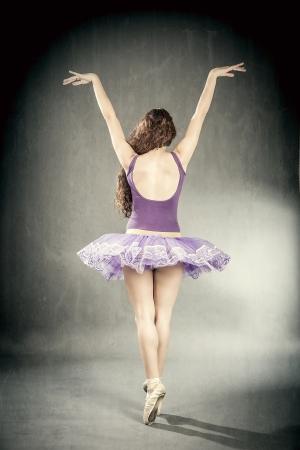 A sexy brunette ballerina in retro style  photo