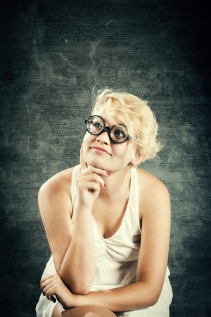 inteligent: cute nerd girl with funny glasses in front of stategic project