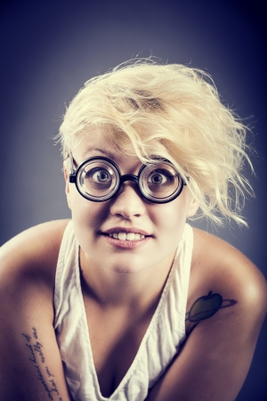 Cute girl with funny glasses looking curious to you Stock Photo - 14450193