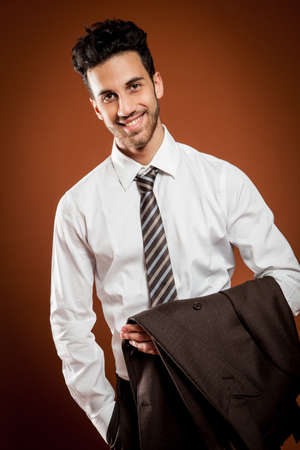 photo of attractive businessman with jacket in his hands photo