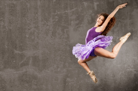 ballerina is jumping on a retro background photo