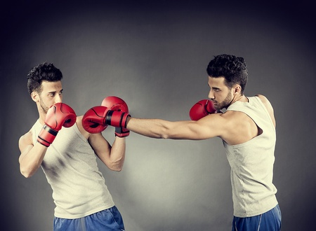 offense: photo of two boxer who are fighting on a grey background Stock Photo