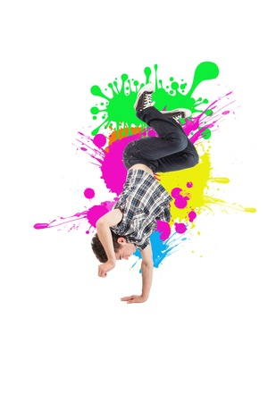 young acrobatic dancer on white background photo