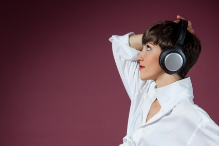 attractive woman with headphones in retrostyle photo