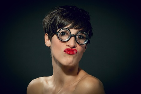horizontale: photo of a sexy female nerd with funny glasses