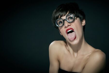 female is making a grimace with her tongue  Stock Photo - 16334693