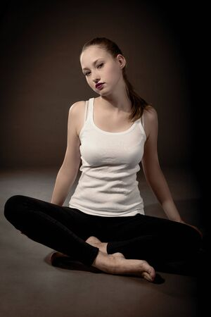 attractive female is sitting on the floor  photo