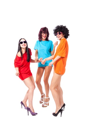 photo of three beautiful ladies dancing in front of a white background photo