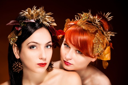 Beautiful Portrait of two womans with luxurious hair style and makeup photo