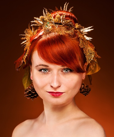 Red Hair Female with luxurious Hair Style and makeup photo