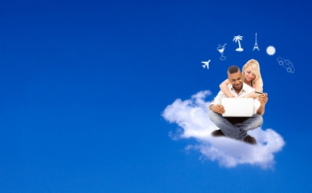 hollidays: Young coupple floating on a cloud booking their hollidays, e-commerce concept