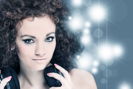 photo of sexy female woman with great curly hairs and headphones - deejay Stock Photo - 17501668