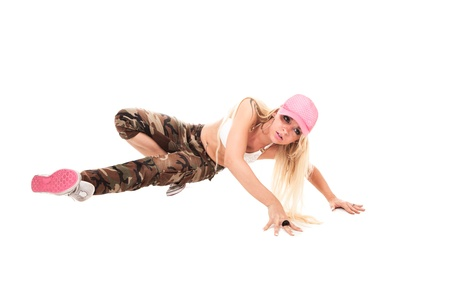 Stockphoto of sexy female break dancer performing a freeze photo