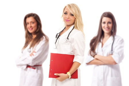 three attractive female doctors, shallow depth of field, isolated photo