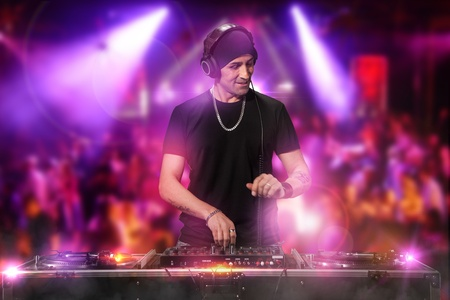Photo of dj working at the disco