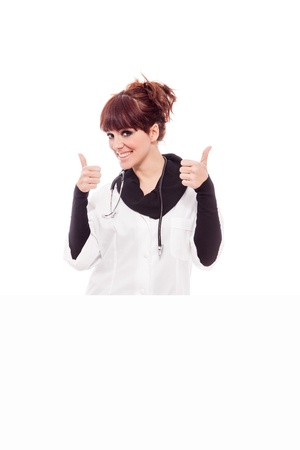 stockphoto: Stockphoto, Smiling brunette female doctor with message board Stock Photo