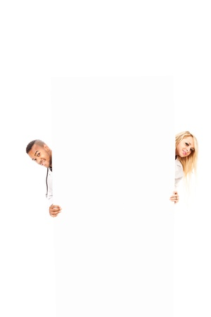 stockphoto: photo of smiling young doctors in front of a white message board, stockphoto