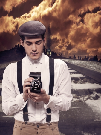 Old style photographer taking a picture in a dangerous situation photo