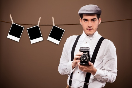 Photo of ancient photographer from the 30s in front of a polaroid background photo