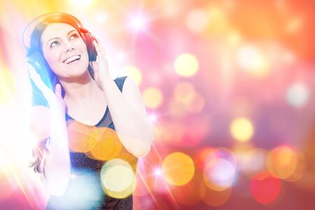 grooves: Conceptual photo of smiling woman listen to music in front of a colorful background